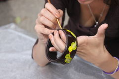 Creative hands. Of woman painting a bracelet Stock Images