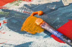 Painting brush on canvas or palette - detail close up.  stock photography