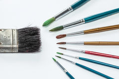 Painting Brush. Various types of brush painting with bright white backgrounds Royalty Free Stock Image