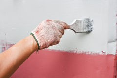 Painting brush worker Royalty Free Stock Photo
