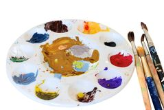 Painting brushes and artist's palette Stock Photos