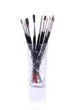 Painting brushes in glass isolated Royalty Free Stock Photos