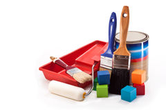 Painting. Brushes, paint, colored blocks, roller, paint tray on a white background Royalty Free Stock Photo