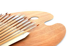 Painting brushes and palette Royalty Free Stock Image