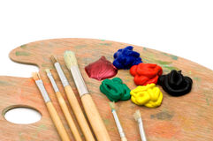 Painting brushes and palette Stock Images