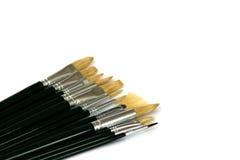 Painting brushes on white background. Set of painting brushes on white background, positioned diagonally Stock Photography
