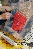 Painting a Buddha image Stock Photo