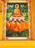 Wall painting of Buddha and monks in Nirvana, Laos. A colorful wall painting of Buddha and Buddhist monks in a Buddhist temple in Vientiane, Laos Royalty Free Stock Photos