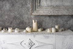 Painting and burnt candles at the fireplace Royalty Free Stock Photo