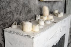 Painting and burnt candles at the fireplace Royalty Free Stock Photos