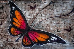 Painting of butterfly. A beautiful painting of butterfly on a brick wall Stock Images