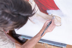 Painting on canvas - painting session Royalty Free Stock Photography