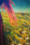 Painting on canvas of a vibrant spring meadow full of wild colorful flowers in the bright sunny day. And detail fairy woman hand Royalty Free Stock Images