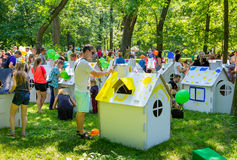 Painting cardboard houses activity for families. Zaporizhia/Ukraine- June 5, 2016: children and adults  participating in painting cardboard houses activity Stock Images