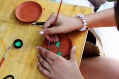 Painting ceramics Stock Images