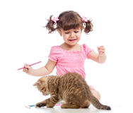 Painting child girl with playful kitten Royalty Free Stock Images