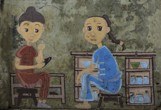 Painting chinese children on the wall Stock Images
