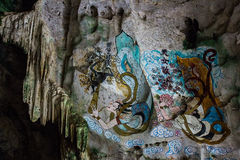Painting of chinese girls on the walls in the cave look like an Stock Image