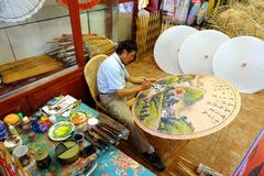Painting Chinese Oil-Paper Umbrellas Stock Photography