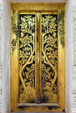 Painting the church door. Classical Traditional Thai style painting art. it must found in a temple Stock Images