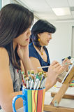 Painting Class. Art class with teen girl and adult Stock Photo