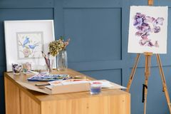 Painting class art draw watercolor design easel. Painting art classes. drawings creation. watercolor floral design on an easel. artist accessories tools and ink royalty free stock photo