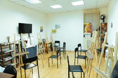 Painting class with easels in it. Art room. Painting class with easels and different equipment in it royalty free stock photos