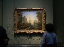 A painting by Claude Lorrain in the National Gallery in London. A painting by Claude Lorrain - Seaport with the Embarkation of Saint Ursula. Beautiful framed Royalty Free Stock Photography