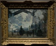 A painting by Claude Monet in the National Gallery in London. A painting by Claude Monet - La Gare Saint-Lazare. Beautiful framed painting in The National Royalty Free Stock Photography