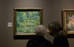 A painting by Claude Monet in the National Gallery in London. A painting by Claude Monet - Water Lily Pond. Beautiful framed painting in The National Gallery Royalty Free Stock Images