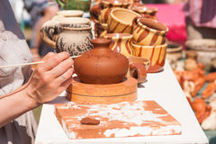 Painting of clay tableware Stock Photo