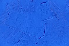 Painting close up of vivid blue color. Paint brush strokes  texture for interesting, creative, imaginative backgrounds. For web and design Royalty Free Stock Image