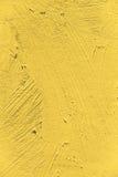 Painting close up of vivid primrose yellow pantone color Stock Photography