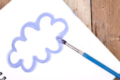 Painting of cloud on notebook Stock Photo