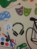 Painting on the wall. Colors bicycle game music   note  earpiece Stock Photo