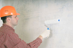 Painting contractor. Wearing in helmet Royalty Free Stock Images
