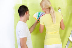 Painting couple choosing color Stock Photo
