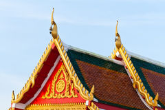 Painting craved front and top roof of budda temple Royalty Free Stock Photos