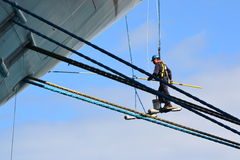 Painting a cruise ship. While at port crew member are busy on maintenance of a ship Royalty Free Stock Photos