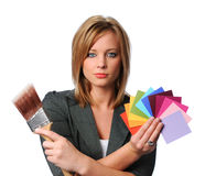 Painting Decisions. Portrait of beautiful woman with paint brush and color swatches Royalty Free Stock Photography
