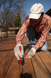 Painting Deck. Wood texture and paintbrush / housework background Stock Images