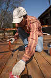 Painting Deck. Wood texture and paintbrush / housework background Stock Photos