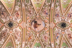 Painting decorated ceiling of an ancient Christian church. Trento, Italy - December 15, 2015: Painting decorated ceiling of an ancient Christian church Royalty Free Stock Images