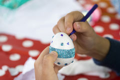 Painting and decorating easter eggs. Easter eggs painting and decoration Royalty Free Stock Photos