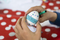 Painting and decorating easter eggs. Easter eggs painting and decoration royalty free stock images