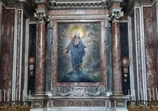 Painting depicting the sacred heart in the Chapel of the Blessed Sacrament of San Lorenzo in Lucina. Pictured is a painting depicting the sacred heart in the Royalty Free Stock Image