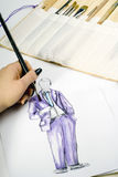 Painting desk. A shot of a woman painting beauty illustrations Royalty Free Stock Photography