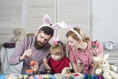 Painting and drawing easter eggs with family. stock photos