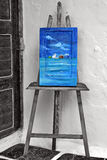 Painting on easel. Art decor with blue painting on easel royalty free stock photos