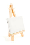 Painting easel with empty canvas Stock Photos